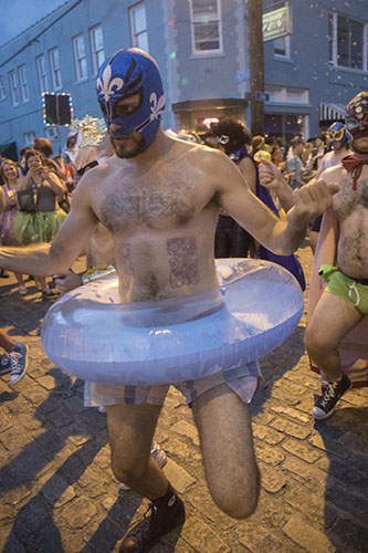 "San Juan of the El Lucha Krewe dances his way down Oak Street during Mid Summer Mardi Gras. The Krewe of O.A.K. celebrated the 30th anniversary of Mid Summer Mardi Gras with the theme ""Get Wet"". (Zach Brien, UptownMessenger.com)"