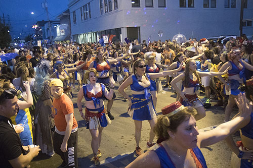 """The Organ Grinders dance their way down Oak street during Mid Summer Mardi Gras. The Krewe of O.A.K. celebrated the 30th anniversary of Mid Summer Mardi Gras with the theme """"Get Wet"""". (Zach Brien, UptownMessenger.com)"""