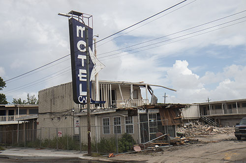 Demolition of the Capri motel began on Tuesday evening. (Zach Brien, UptownMessenger.com)