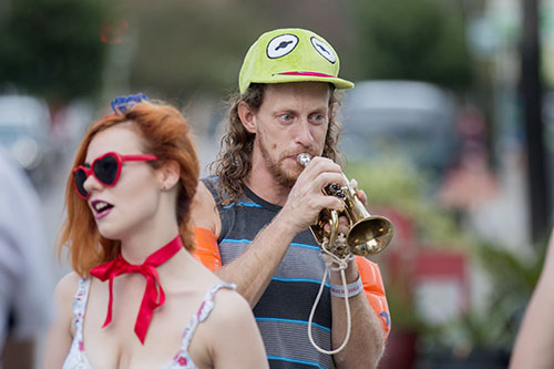 """Dan Ruch of the Browncoat Brass warms up before Mid Summer Mardi Gras. The Krewe of O.A.K. celebrated the 30th anniversary of Mid Summer Mardi Gras with the theme """"Get Wet"""". (Zach Brien, UptownMessenger.com)"""