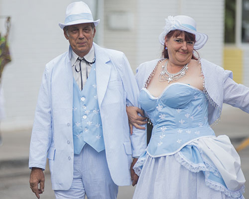 """Norman, left, and Christine Smith, right, show off their home made seersucker costumes. The Krewe of O.A.K. celebrated the 30th anniversary of Mid Summer Mardi Gras with the theme """"Get Wet"""". (Zach Brien, UptownMessenger.com)"""