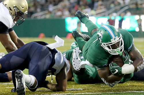 Tulane running back Josh Rounds dives for a touchdown. Navy defeated Tulane 21-14 at Yulman Stadium. (Zach Brien, UptownMessenger.com)