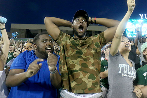 Trevarius Hopkins and La'travion Jackson celebrate a Tulane touchdown in the student section of Yulman Stadium. Tulane defeated Southern University 66 to 21 at their home opener at Yulman Stadium. (Zach Brien, UptownMessenger.com)