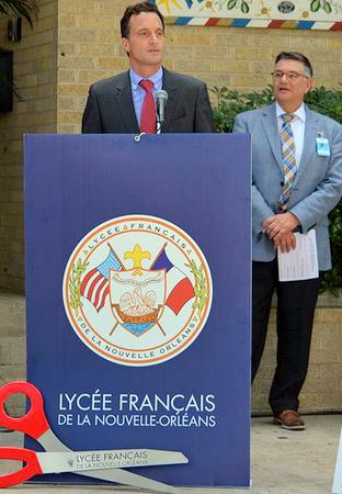 French consul Gregor Trumel speaks as Lycee CEO Keith Bartlett listens Sept. 15 at the ribbon cutting for the school's newest location at Central St. Matthew UCC on South Carrollton Avenue. (via Lycee Francais on Facebook)