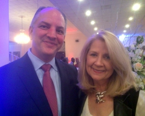 Gov. John Bel Edwards poses for a photo with Wilma Heaton of the Southeast Louisiana Flood Protection Authority East. (photo by Danae Columbus for UptownMessenger.com)