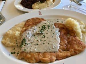 Canal Street Bistro JagerSchnitzel with Mushroom Cream Sauce, Kartoffelbrie and Sauerkraut Kristine Froeba)