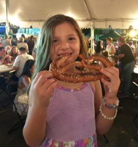 Five year old Ava Montalbano, Pretezl Afficiandao and student at Kenner Discovery Riverotwn Campus waited 45 minutes for her Pretzel. Verdict: Worth It! (Kristine Froeba)