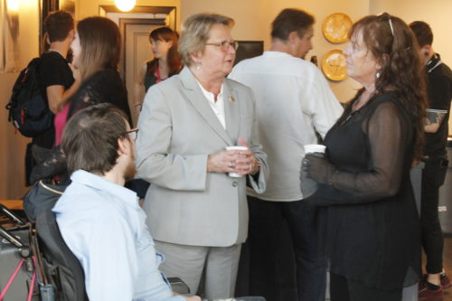 """Jesse Bascle (left) speaks to Susan Guidry and his mother Sue Ford (right) at the """"Jonah Stands Up"""" pre-screening party at the Ace Hotel. (Jamal Melancon, Gentilly Messenger)"""