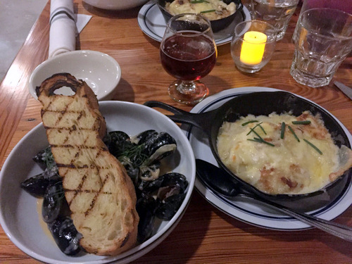 The steamed mussels on the small plate menu paired with Lagunitas Brown Shugga' and a side of potato/ turnip gratin. (Photo by Dannielle Garcia)